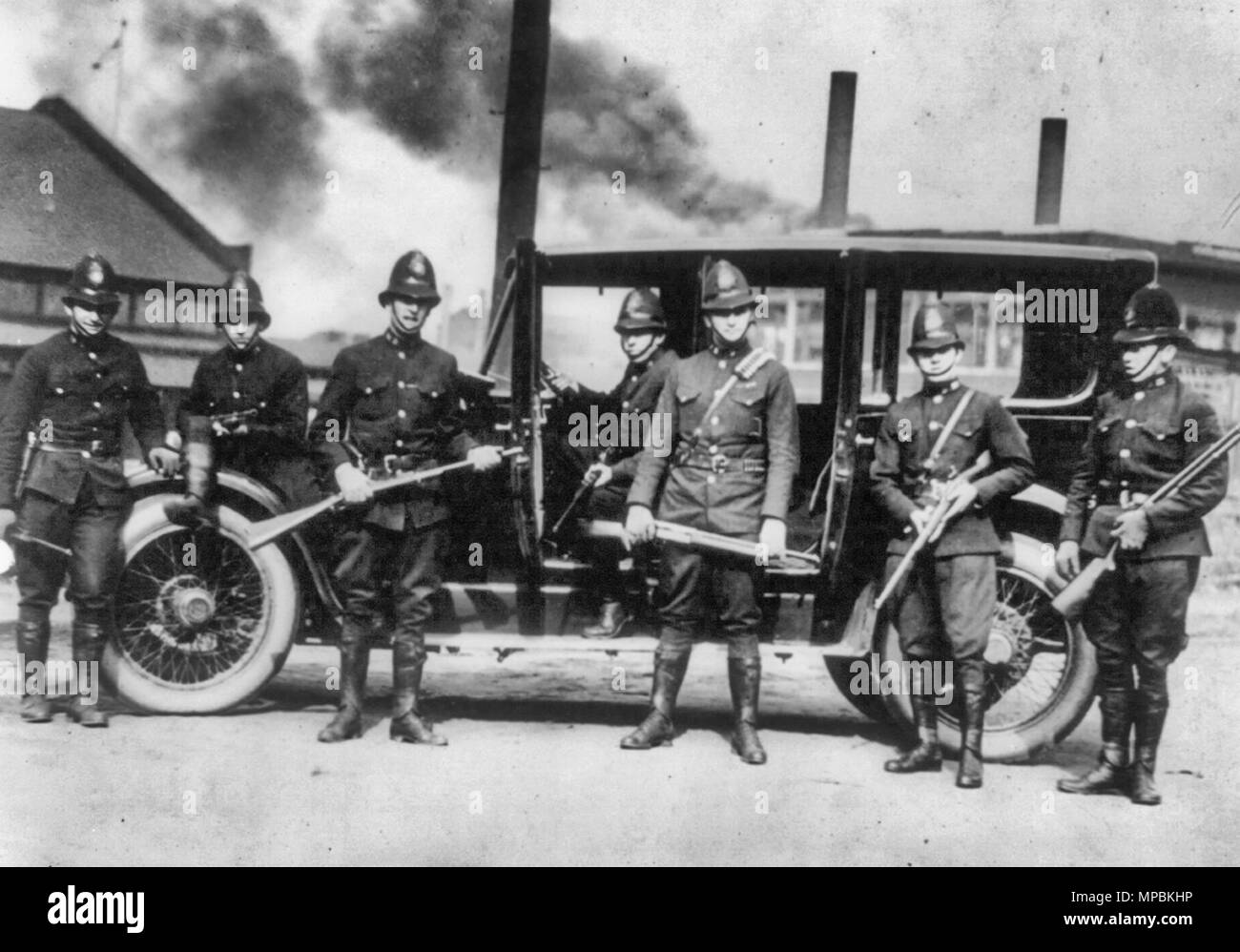 Latest news from the steel district - State troopers ready for a hurry call at Farrell, Pennsylvania - Seven posed with riot guns. 1919 - Stock Image