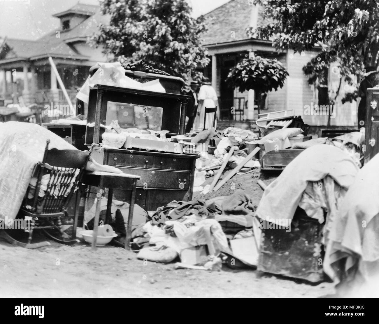 Furniture in street during race riot, probably due to eviction, Tulsa, Oklahoma, 1921 - Stock Image