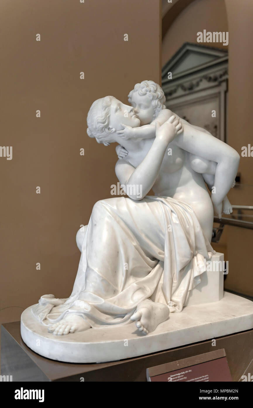 London, UK - April 2018: Marble sculpture titled Maternal Affection by Edward Hodges Baily exhibited at Victoria and Albert Museum - Stock Image