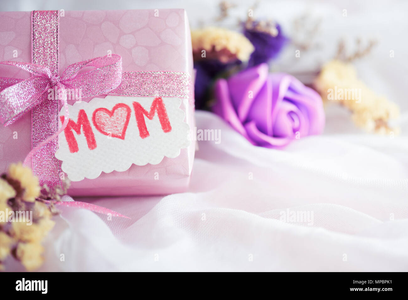 Happy Mothers Day Concept Gift Box With Purple Flower Paper Tag