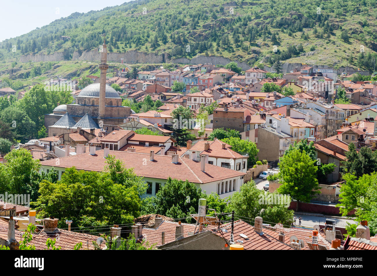 With houses with wooden shutters in the classic Turkish Ottoman style and mosque,  top view. Afyonkarahisar in Turkey, - Stock Image