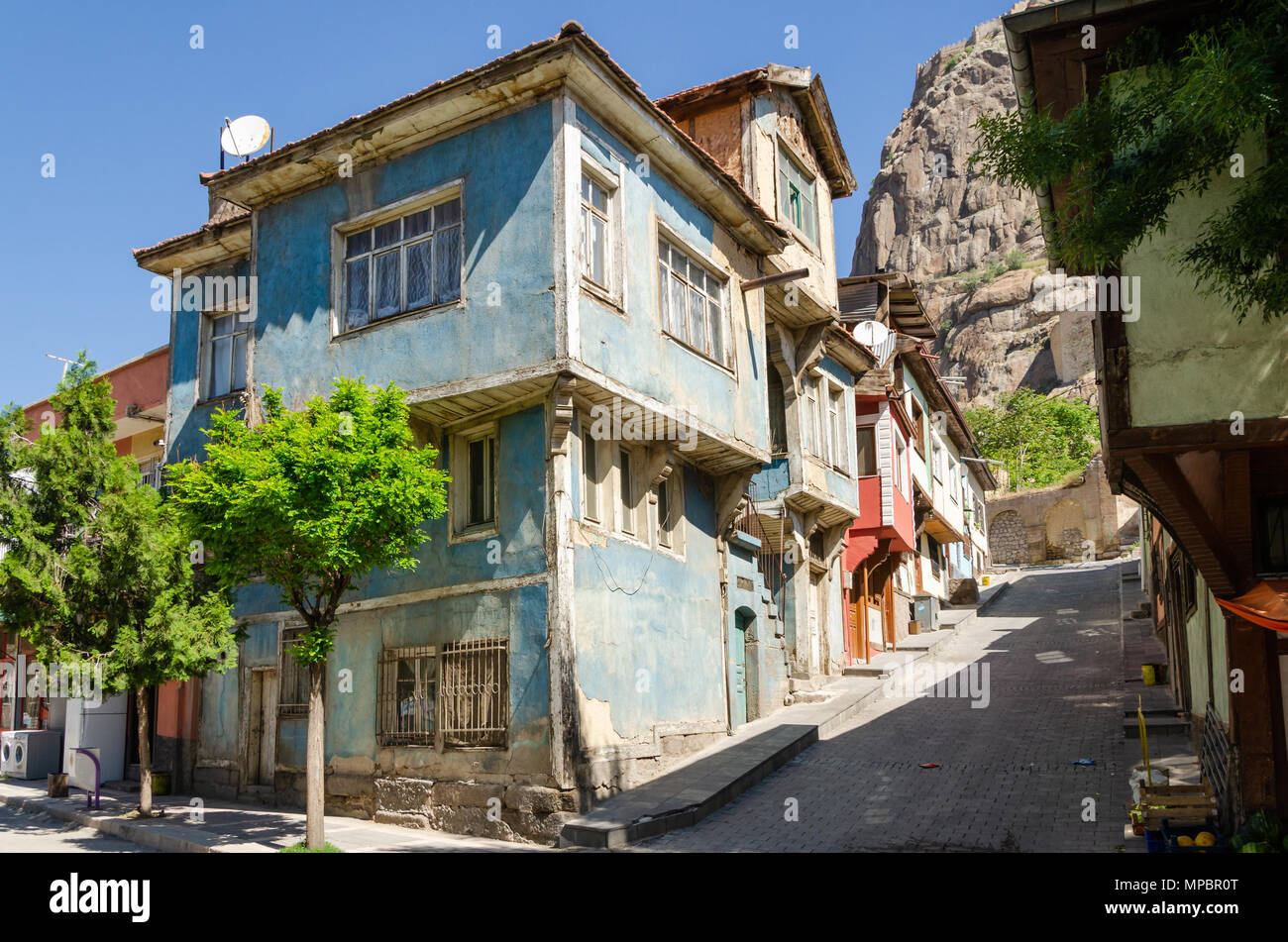 Beautiful old street in downtown with houses with wooden shutters in the classic Turkish Ottoman style, Turkey, center of Afyonkarahisar The two-story - Stock Image
