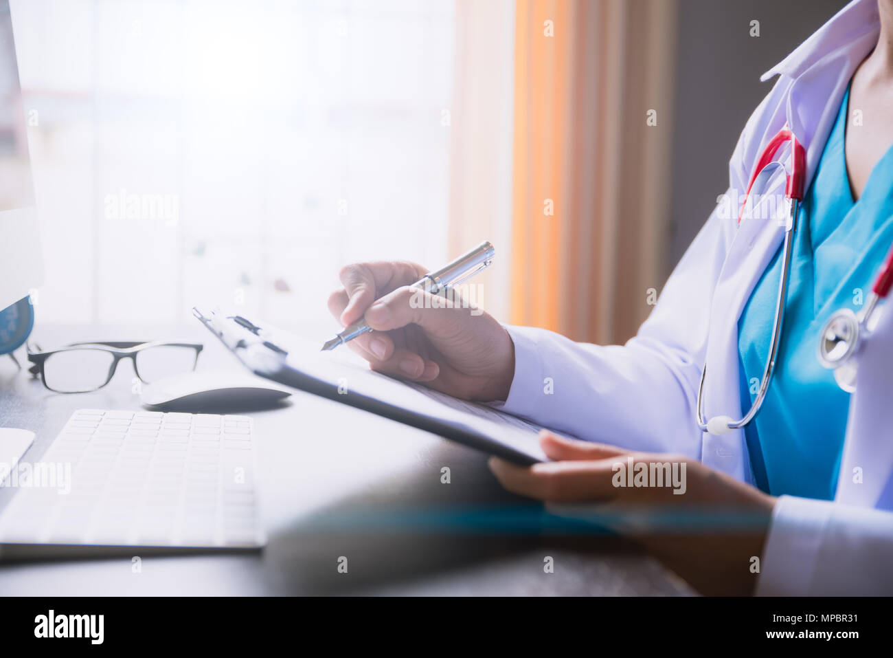Soft focus of doctor hand holding application form or ... on medical assistant job application, office assistant job application, restaurant job application, medical center job application,