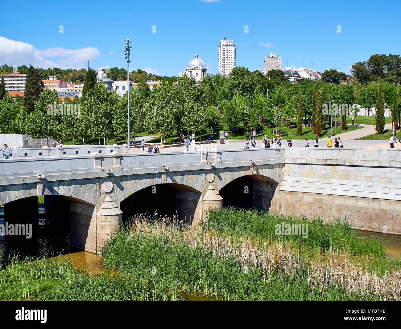 Puente del Rey bridge over the Manzanares river in Madrid Rio at spring day with Principe Pio and Plaza de Espana in background. Stock Photo