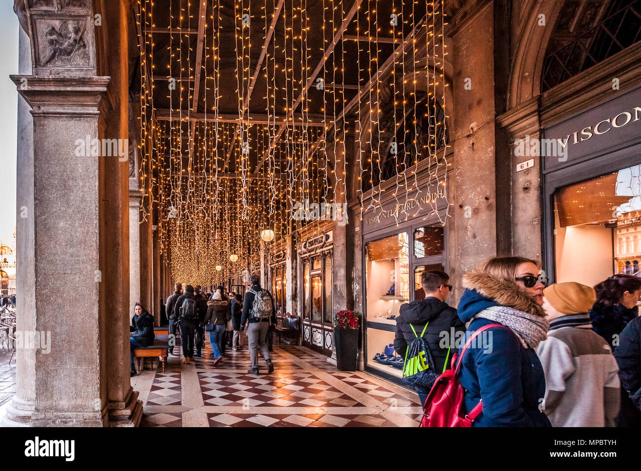 venice italy january 02 2018 christmas lights over shop windows in the san marco square colonnade
