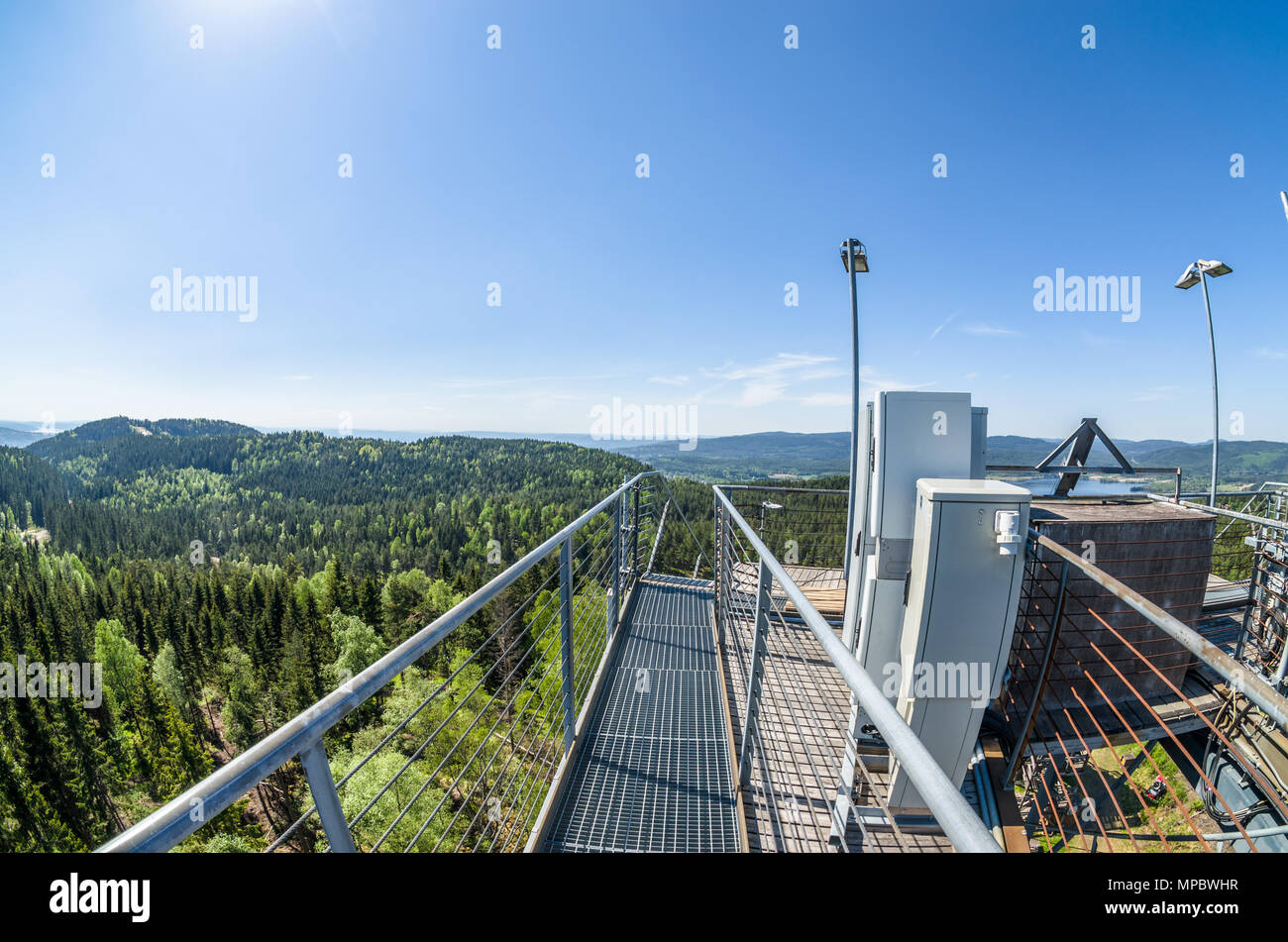 Linderud ski jumping tower out of season in late spring sunny day. - Stock Image