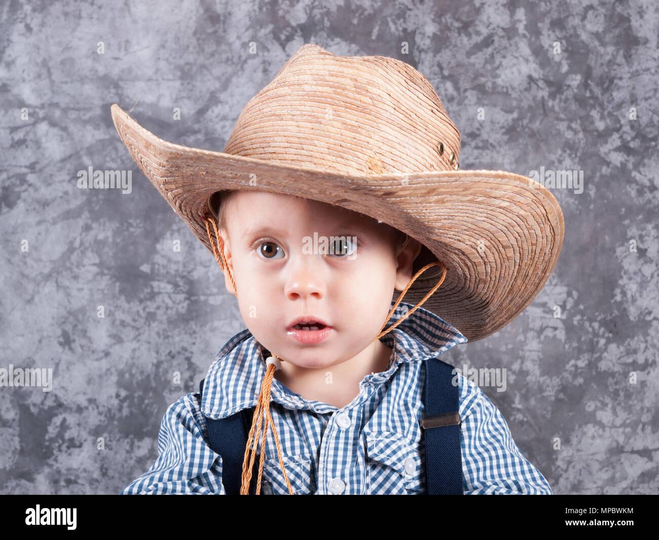 7b74788424bcd Little cute kid in cowboy straw hat Stock Photo  185887736 - Alamy