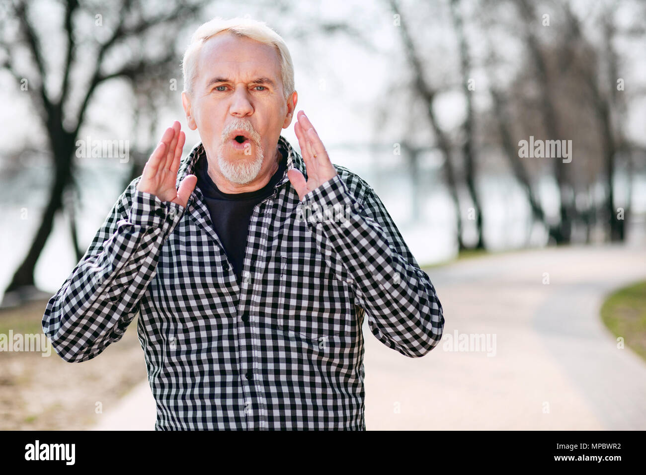 Pleasant senior man bawling - Stock Image