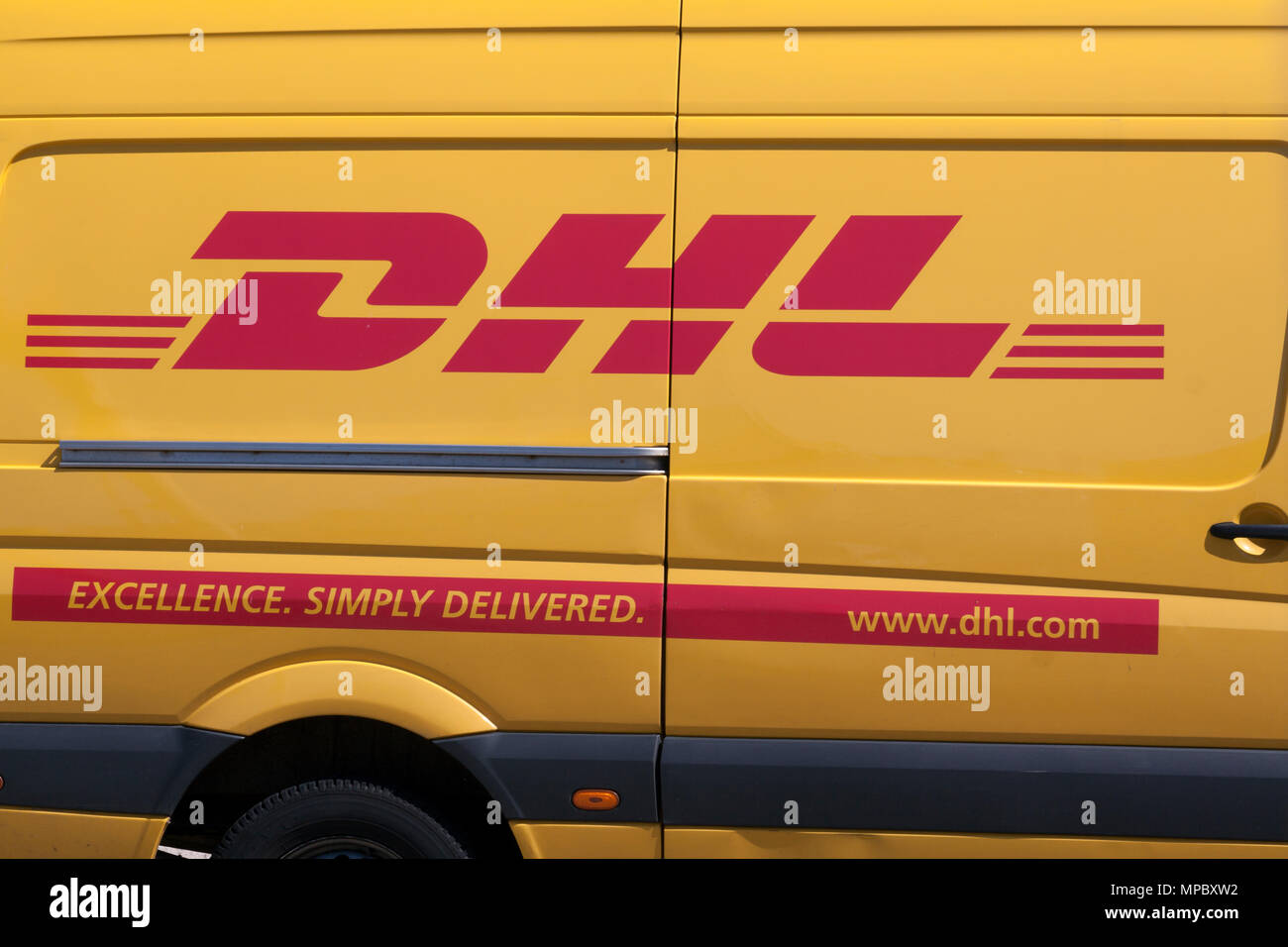 Amsterdam,netherlands-july 21, 2015: DHL side of a car,dhl is  especially active as a courier company for the delivery of parcels and letters - Stock Image