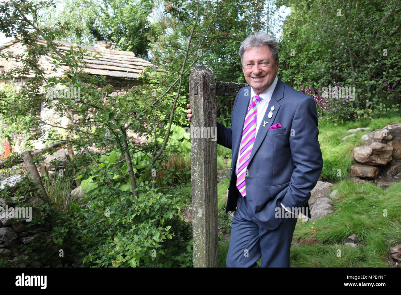 Chelsea, London, UK. 21st May, 2018. Chelsea, London, UK. 21st May 2018. Sir Alan Titchmarsh on the Welcome to Yorkshire garden at Chelsea Flower Show 2018, designed by Mark Gregory for Landformconsultants.co.uk Credit: Jenny Lilly/Alamy Live News - Stock Image