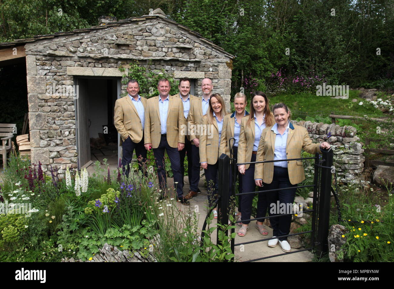 Chelsea, London, UK. 21st May, 2018. The Welcome to Yorkshire team on the Welcome to Yorkshire garden with Sir Gary Verity DL Chief Executive of WTY at Chelsea Flower Show 2018, designed by Mark Gregory for Landformconsultants.co.uk Credit: Jenny Lilly/Alamy Live News - Stock Image