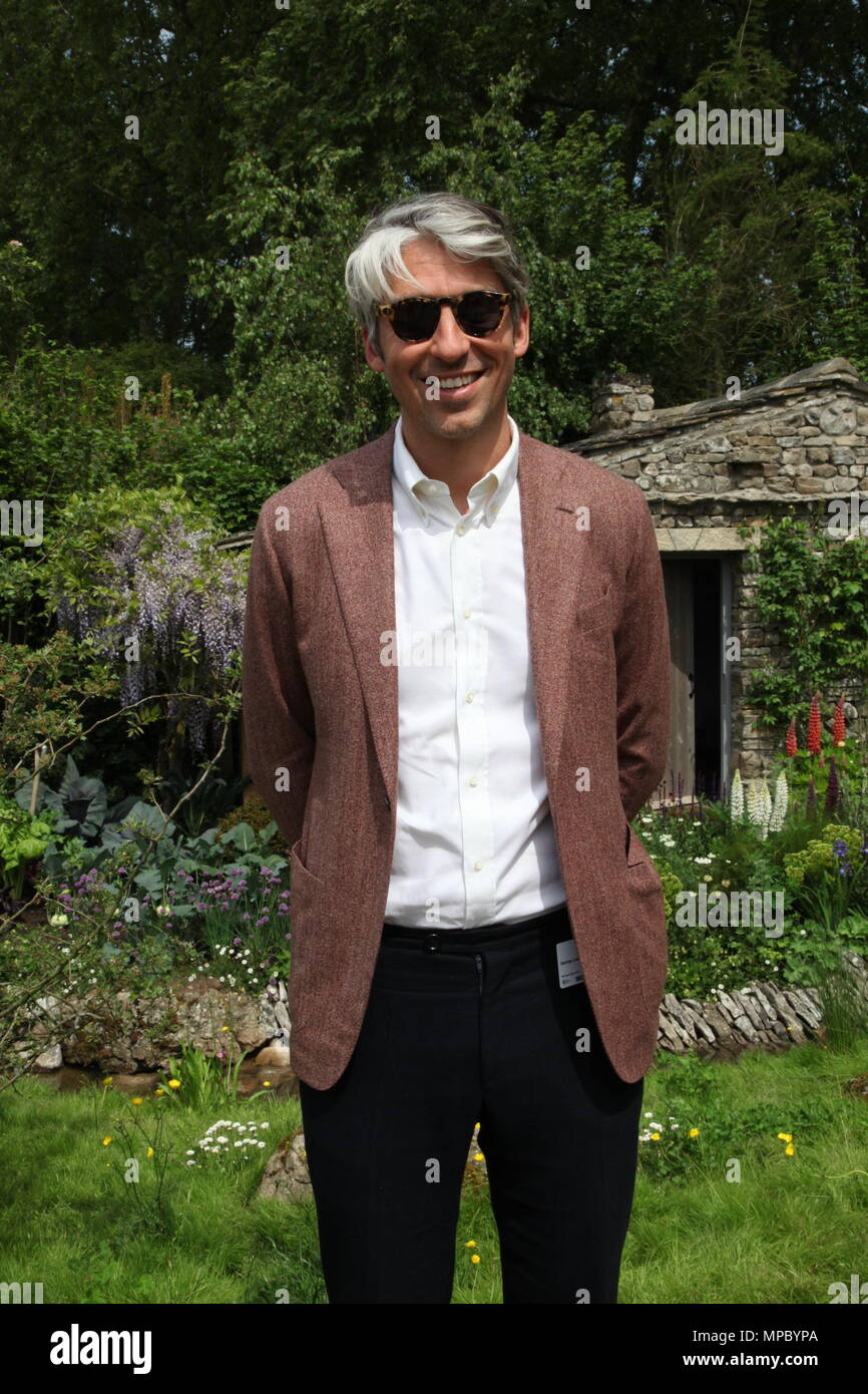 Chelsea, London, UK. 21st May, 2018. Chelsea, London, UK. 21st May 2018. George Lamb on the Welcome to Yorkshire garden at Chelsea Flower Show 2018, designed by Mark Gregory for Landformconsultants.co.uk Credit: Jenny Lilly/Alamy Live News - Stock Image