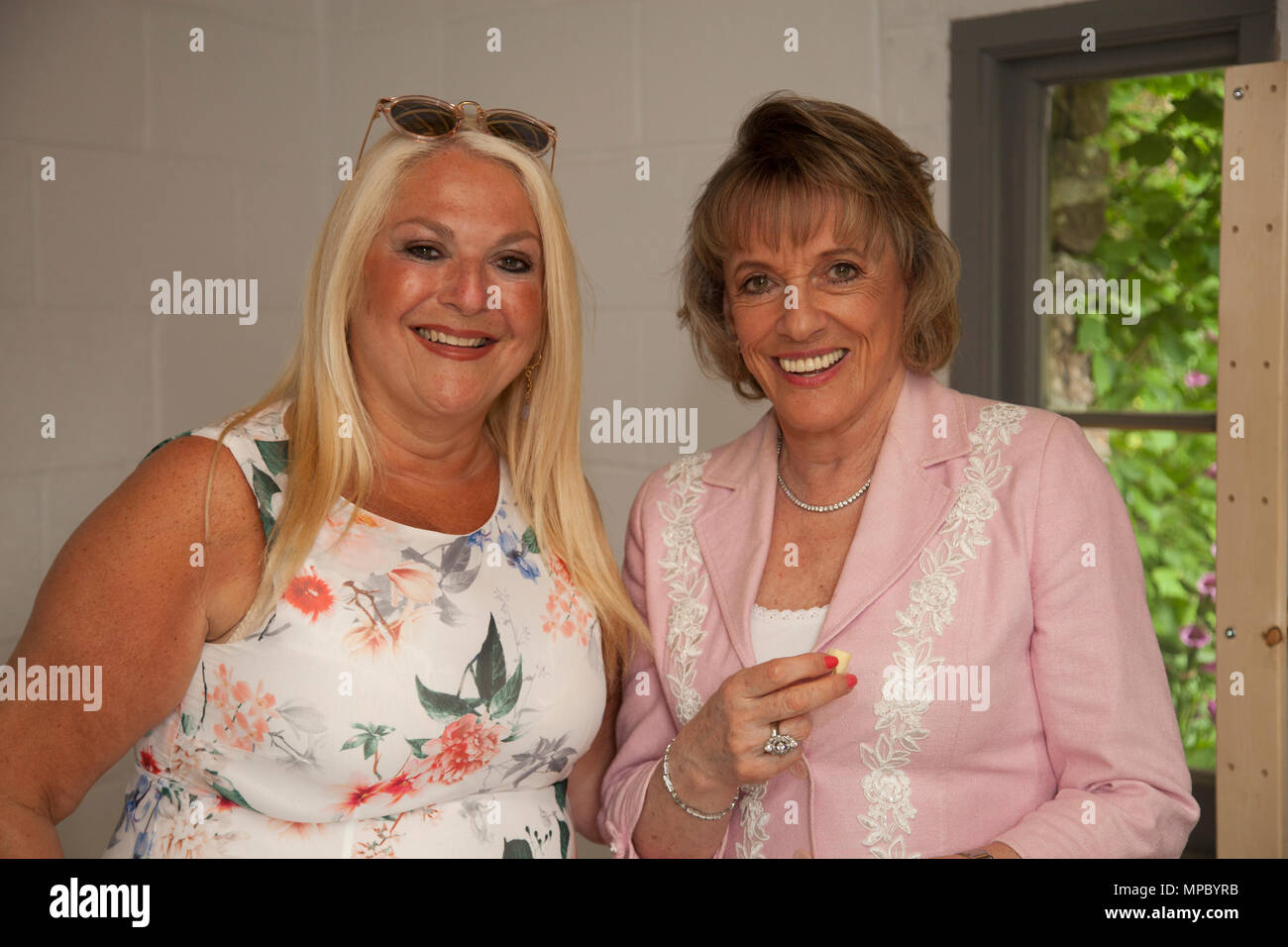 Chelsea, London, UK. 21st May, 2018. Chelsea, London, UK. 21st May 2018. Dame Esther Rantzen and Vanessa Feltz on the Welcome to Yorkshire garden at Chelsea Flower Show 2018, designed by Mark Gregory for Landformconsultants.co.uk Credit: Jenny Lilly/Alamy Live News - Stock Image