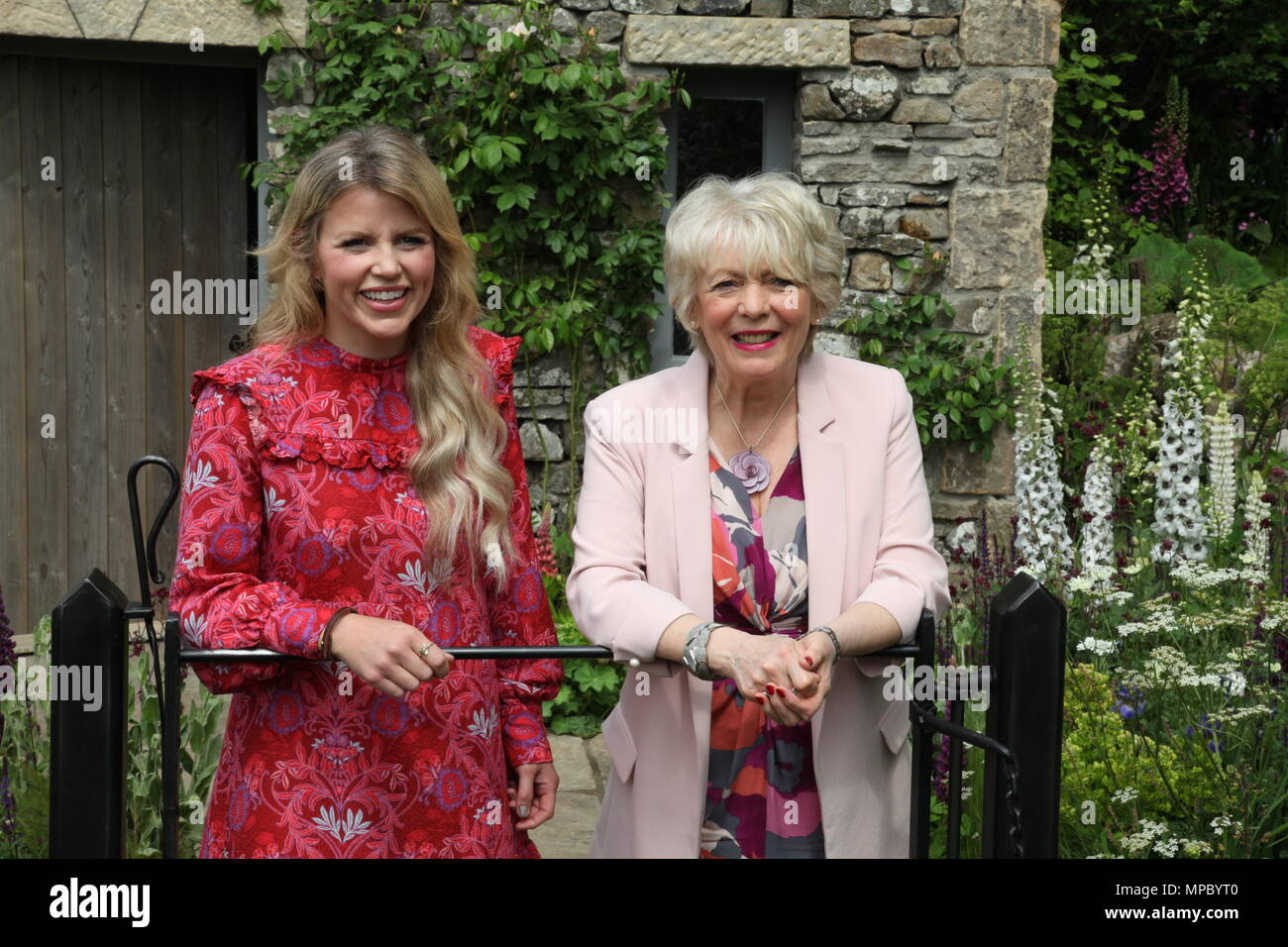 Chelsea, London, UK. 21st May, 2018. Chelsea, London, UK. 21st May 2018. Ellie Harrison and Alison Steadman on the Welcome to Yorkshire garden at Chelsea Flower Show 2018, designed by Mark Gregory for Landformconsultants.co.uk Credit: Jenny Lilly/Alamy Live News - Stock Image