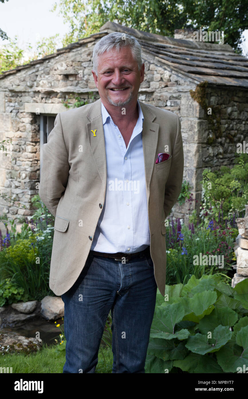 Chelsea, London, UK. 21st May, 2018. Mark Gregory, Designer on the Welcome to Yorkshire garden at Chelsea Flower Show 2018, designed by Mark Gregory for Landformconsultants.co.uk Credit: Jenny Lilly/Alamy Live News - Stock Image