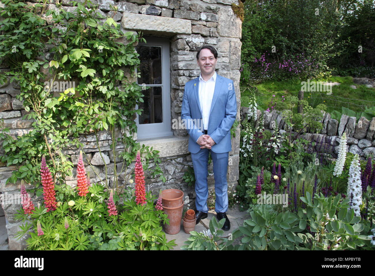 Chelsea, London, UK. 21st May, 2018. Chelsea, London, UK. 21st May 2018. Reece Shearsmith on the Welcome to Yorkshire garden at Chelsea Flower Show 2018, designed by Mark Gregory for Landformconsultants.co.uk Credit: Jenny Lilly/Alamy Live News - Stock Image
