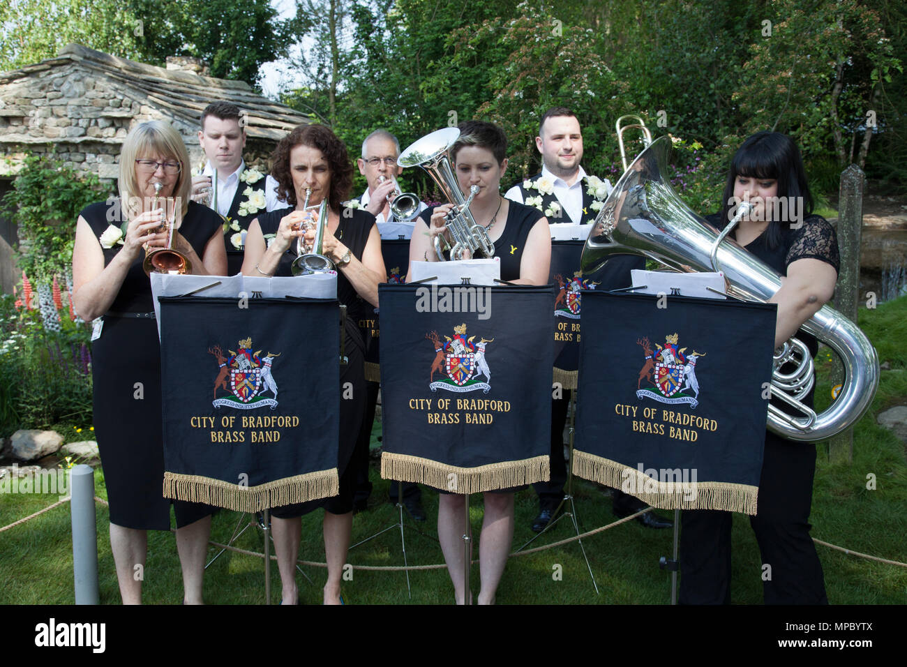 Chelsea, London, UK. 21st May, 2018. City of Bradford Brass Band on the Welcome to Yorkshire garden at Chelsea Flower Show 2018, designed by Mark Gregory for Landformconsultants.co.uk Credit: Jenny Lilly/Alamy Live News - Stock Image