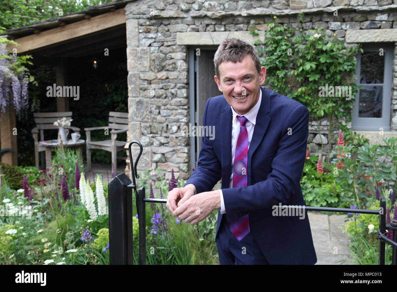 Chelsea, London, UK. 21st May, 2018. Chelsea, London, UK. 21st May 2018. Matthew Wright on the Welcome to Yorkshire garden at Chelsea Flower Show 2018, designed by Mark Gregory for Landformconsultants.co.uk Credit: Jenny Lilly/Alamy Live News - Stock Image