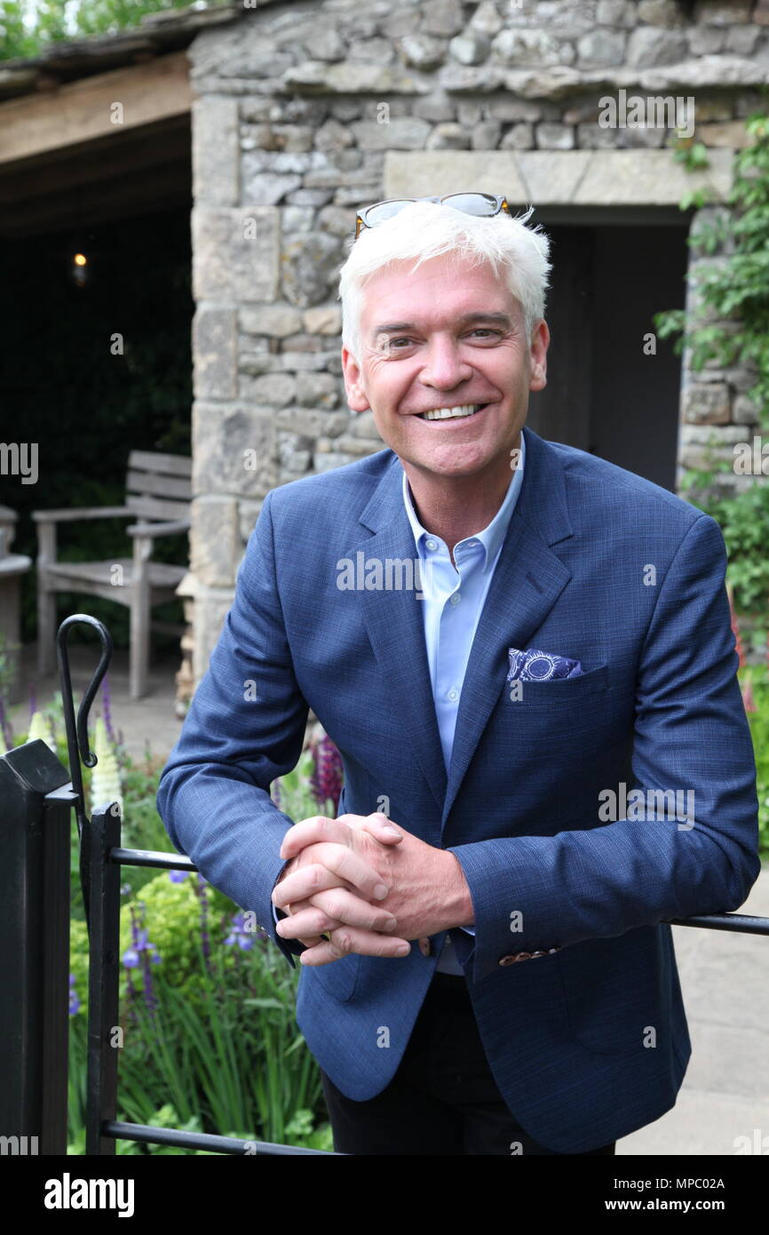 Chelsea, London, UK. 21st May, 2018. Chelsea, London, UK. 21st May 2018. Phillip Schofield on the Welcome to Yorkshire garden at Chelsea Flower Show 2018, designed by Mark Gregory for Landformconsultants.co.uk Credit: Jenny Lilly/Alamy Live News - Stock Image