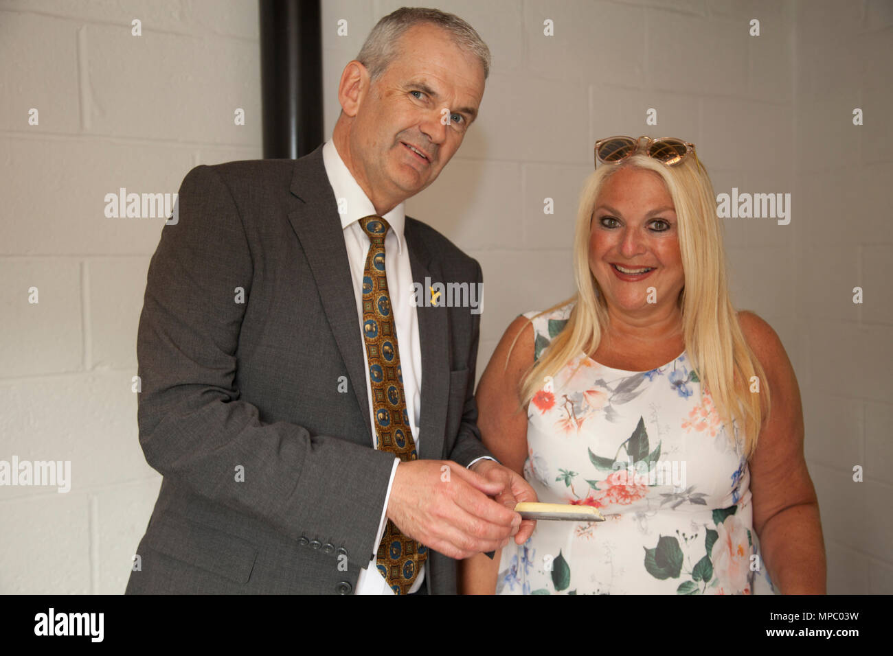 Chelsea, London, UK. 21st May, 2018. David Hartley Managing Director of Wensleydale Creamery and Vanessa  Feltz  cheese tasting in the bothy on the Welcome to Yorkshire garden at Chelsea Flower Show 2018, designed by Mark Gregory for Landformconsultants.co.uk Credit: Jenny Lilly/Alamy Live News - Stock Image