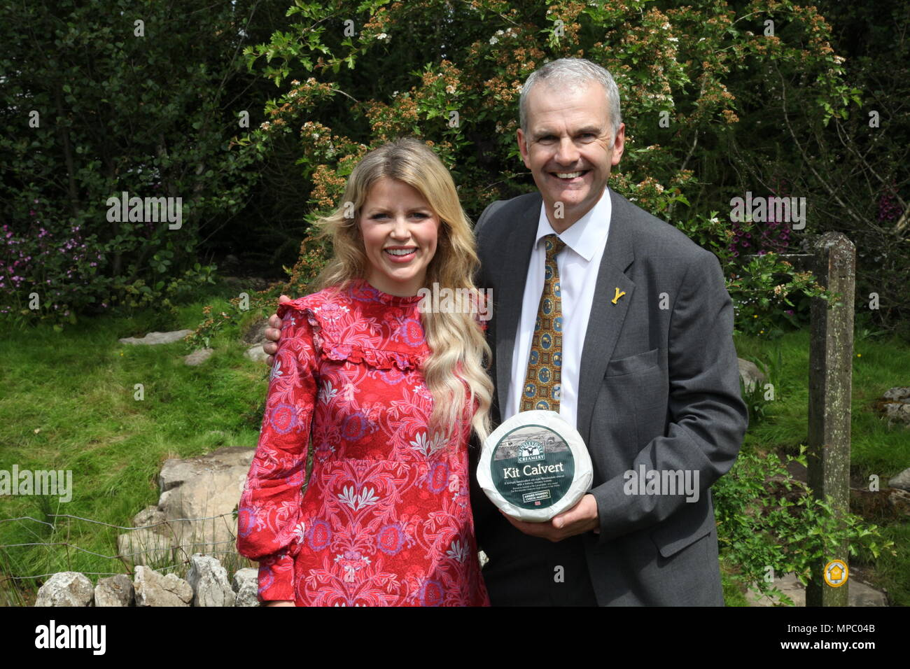 Chelsea, London, UK. 21st May, 2018. David Hartley Managing Director of Wensleydale Creamery and Ellie Harrison on the Welcome to Yorkshire garden at Chelsea Flower Show 2018, designed by Mark Gregory for Landformconsultants.co.uk Credit: Jenny Lilly/Alamy Live News - Stock Image