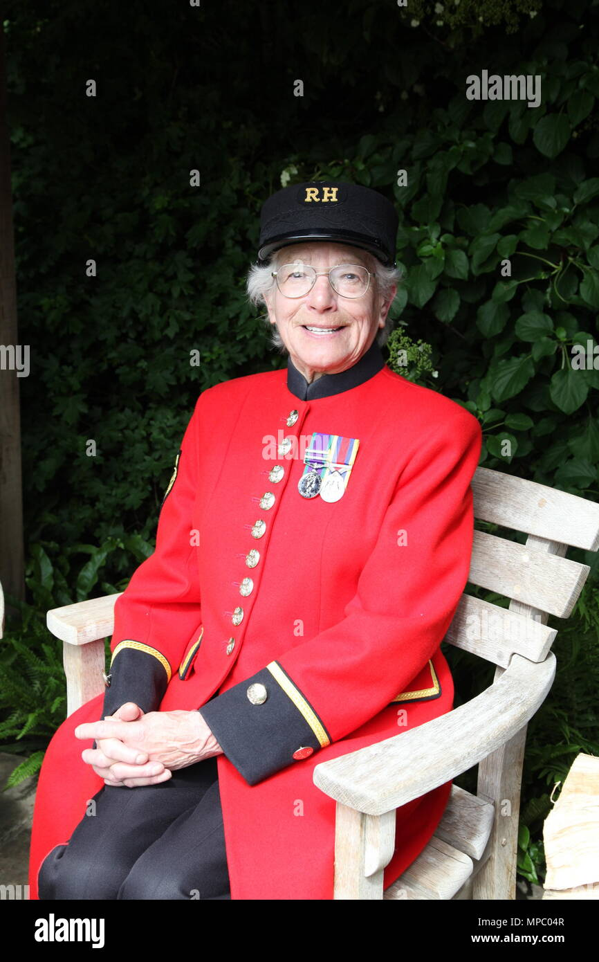 Chelsea, London, UK. 21st May, 2018. Marjorie Cole, Chelsea Pensioner on the Welcome to Yorkshire garden at Chelsea Flower Show 2018, designed by Mark Gregory for Landformconsultants.co.uk Credit: Jenny Lilly/Alamy Live News - Stock Image
