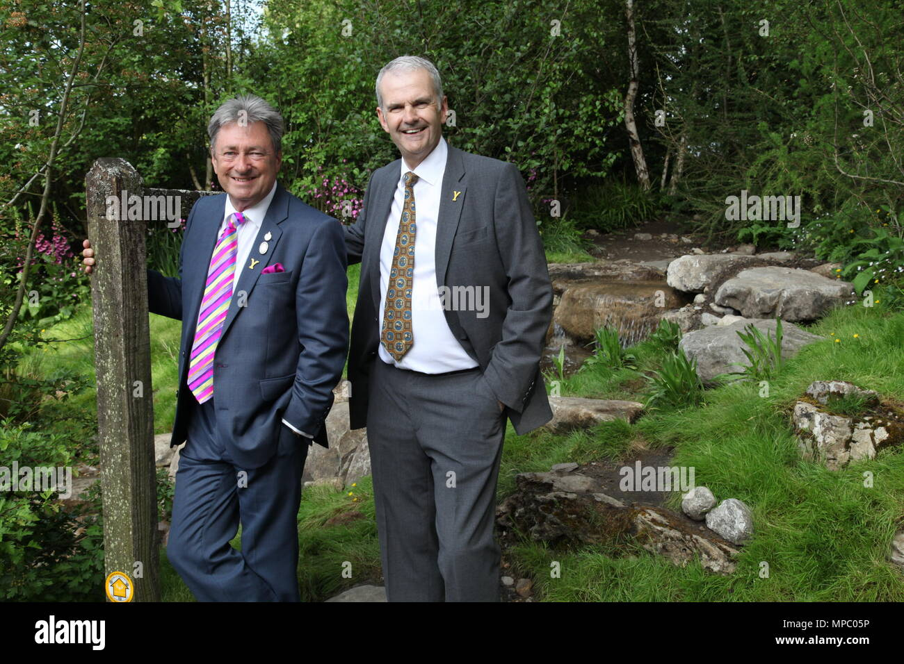Chelsea, London, UK. 21st May, 2018. Sir Alan Titchmarsh with David Hartley Managing Director of Wensleydale Creamery on the Welcome to Yorkshire garden at Chelsea Flower Show 2018, designed by Mark Gregory for Landformconsultants.co.uk Credit: Jenny Lilly/Alamy Live News - Stock Image