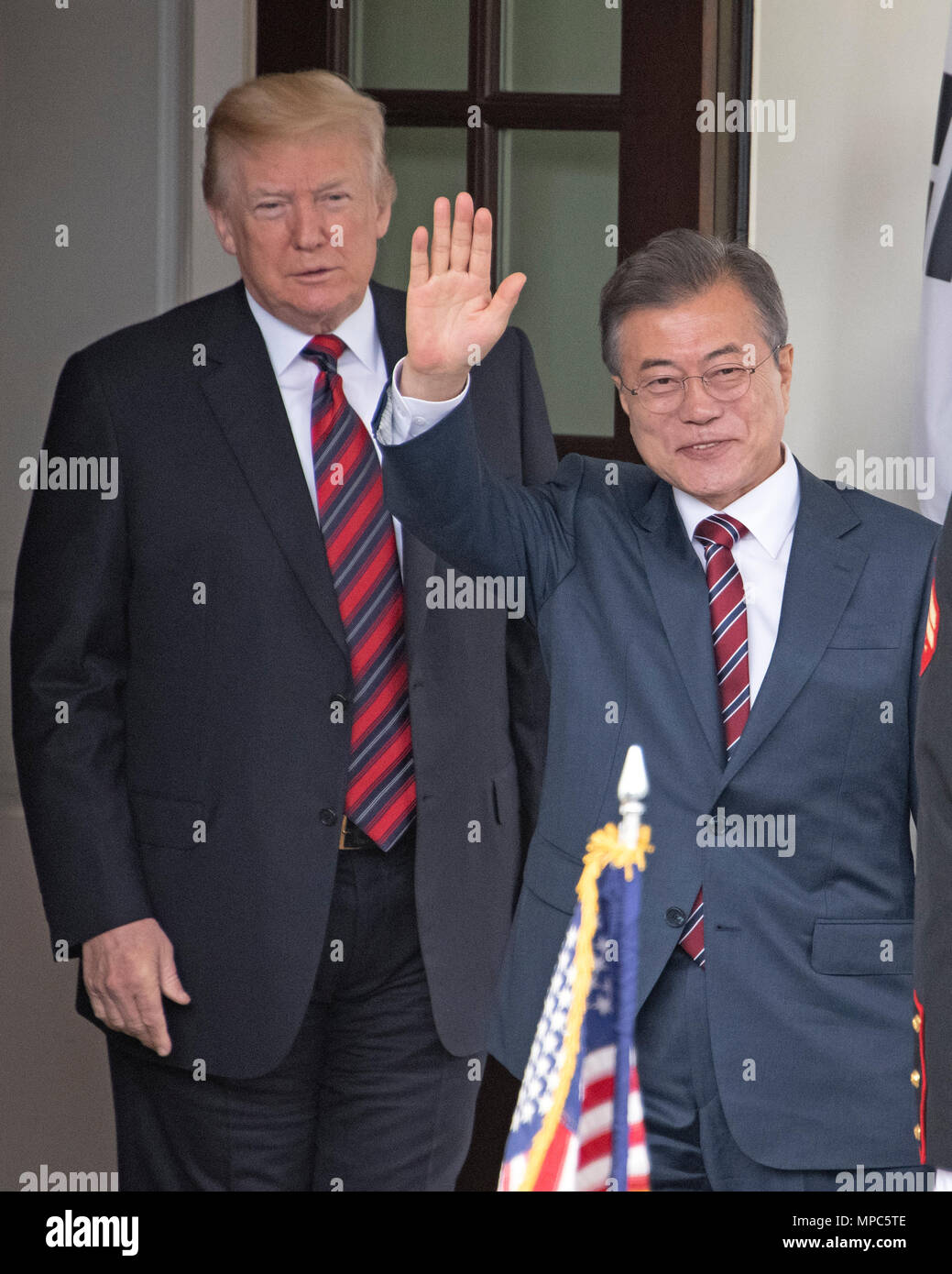 Singapore. 12th June, 2018. United States President Donald J. Trump looks on as President Moon Jae-in of South Korea waves to the assembled press as he arrives for talks at the White House in Washington, DC on Tuesday, May 22, 2018. The two leaders are meeting ahead of President Trump's scheduled summit with Kim Jung-un of North Korea which is tentatively scheduled for June 12, 2018 in Singapore. Credit: Ron Sachs/CNP | usage worldwide Credit: dpa/Alamy Live News - Stock Image