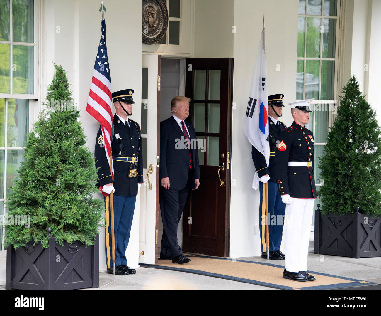 Singapore. 12th June, 2018. United States President Donald J. Trump emerges from the White House to welcome President Moon Jae-in of South Korea for talks at the White House in Washington, DC on Tuesday, May 22, 2018. The two leaders are meeting ahead of President Trump's scheduled summit with Kim Jung-un of North Korea which is tentatively scheduled for June 12, 2018 in Singapore. Credit: Ron Sachs/CNP | usage worldwide Credit: dpa/Alamy Live News - Stock Image