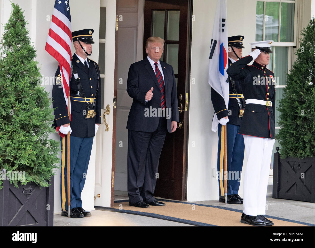 Singapore. 12th June, 2018. United States President Donald J. Trump gestures towards the assembled press as he prepares to welcome President Moon Jae-in of South Korea for talks at the White House in Washington, DC on Tuesday, May 22, 2018. The two leaders are meeting ahead of President Trump's scheduled summit with Kim Jung-un of North Korea which is tentatively scheduled for June 12, 2018 in Singapore. Credit: Ron Sachs/CNP | usage worldwide Credit: dpa/Alamy Live News - Stock Image