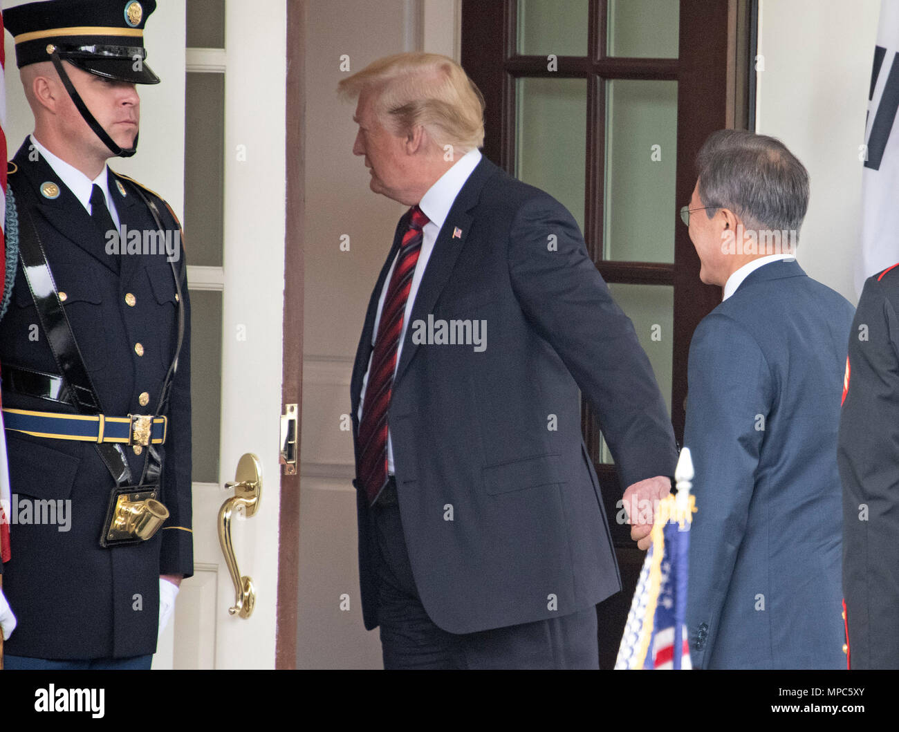 Singapore. 12th June, 2018. United States President Donald J. Trump holds the hand of President Moon Jae-in of South Korea as he arrives for talks at the White House in Washington, DC on Tuesday, May 22, 2018. The two leaders are meeting ahead of President Trump's scheduled summit with Kim Jung-un of North Korea which is tentatively scheduled for June 12, 2018 in Singapore. Credit: Ron Sachs/CNP | usage worldwide Credit: dpa/Alamy Live News - Stock Image