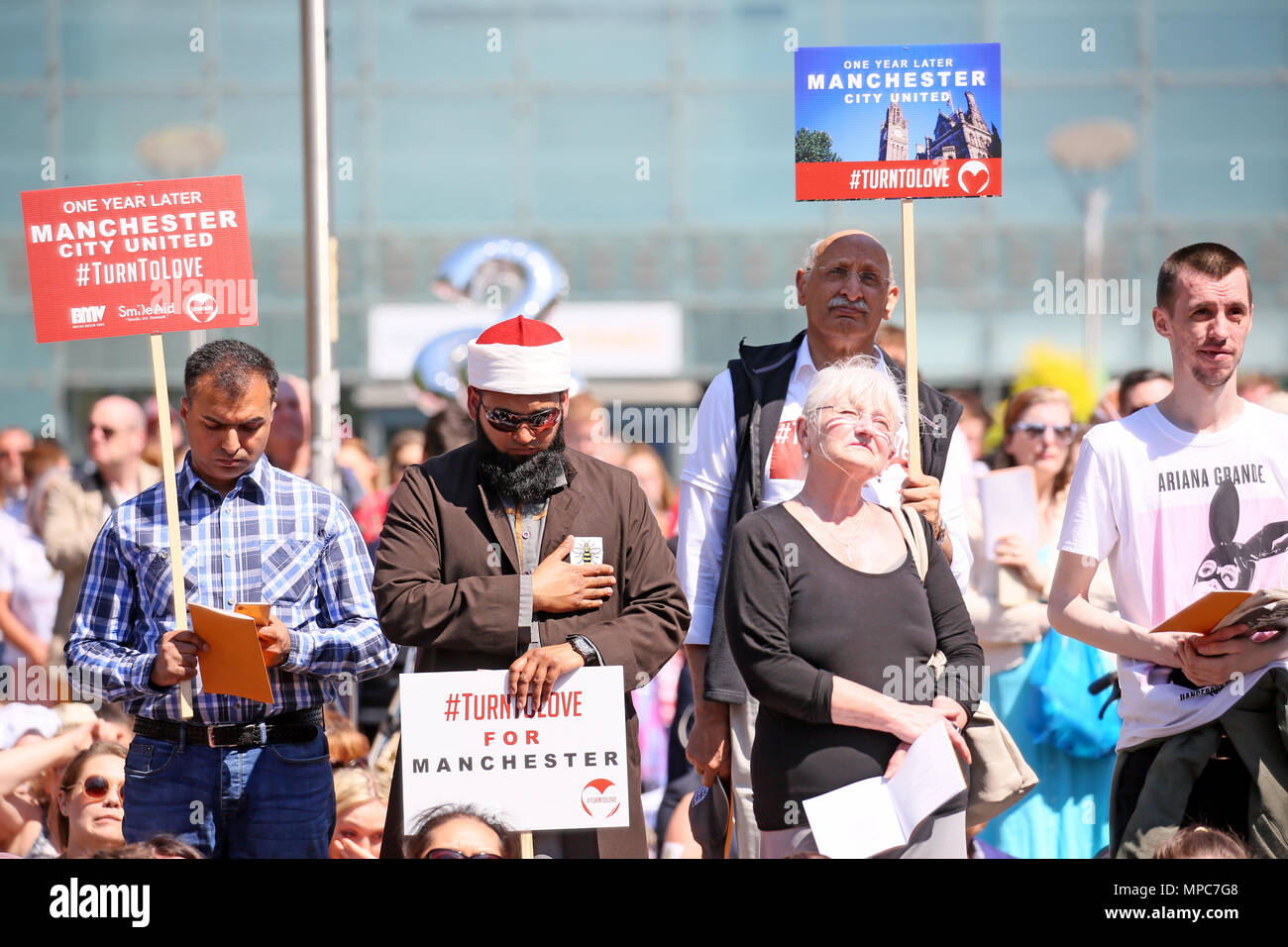 Manchester, UK. 22nd May 2018. Crowds fill Cathedral Gardens to watch a big screen of the service taking place on the 1st  memorial of the arena bomb inside the cathedral, Manchester, 22nd May, 2018 (C)Barbara Cook/Alamy Live News - Stock Image