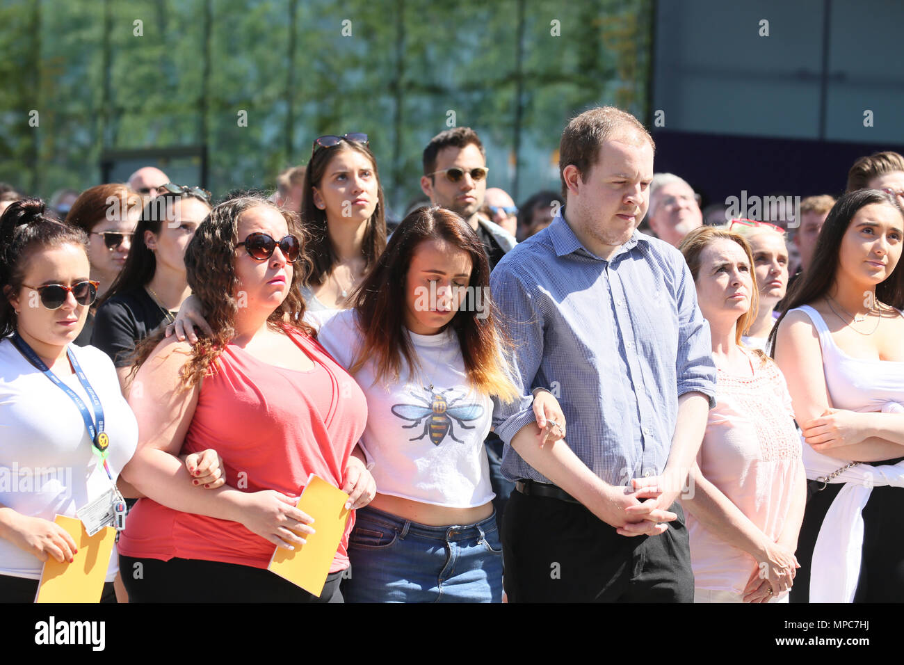 Manchester, UK. 22nd May 2018. People gather in Cathedral Gardens to watch a big screen of the Memorial service taking place inside the Cathedral for the 1st  memorial of the arena bomb, Manchester, 22nd May, 2018 (C)Barbara Cook/Alamy Live News - Stock Image