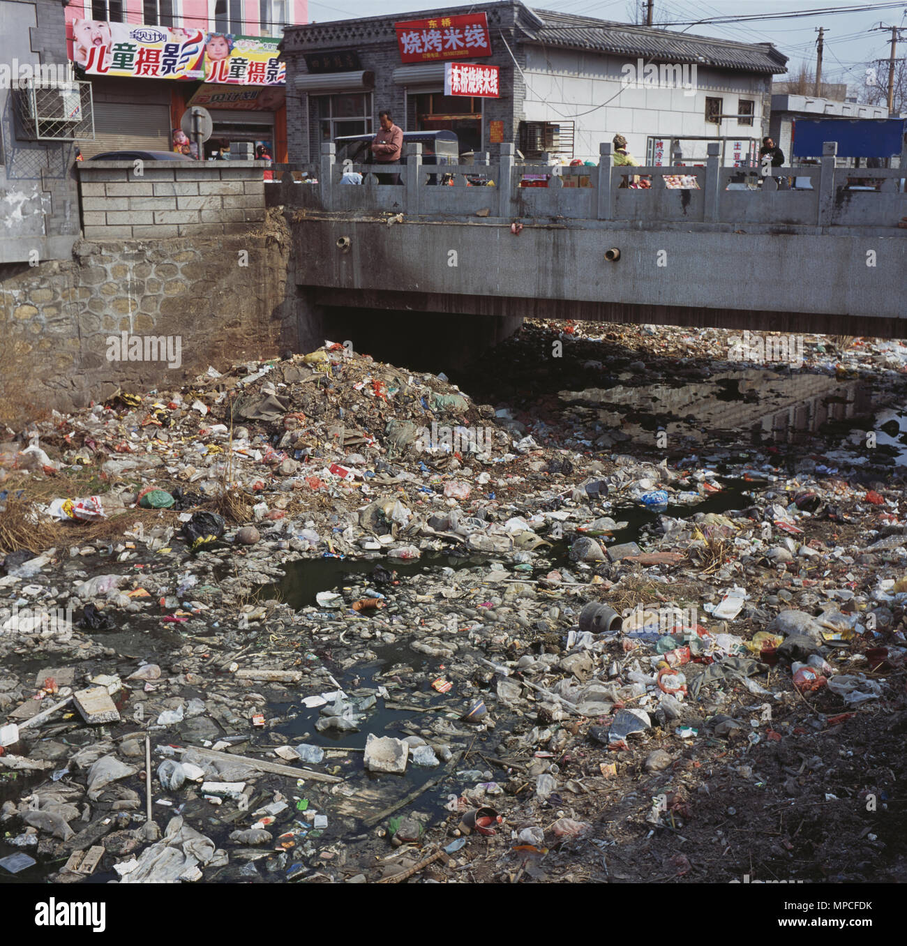 A town river is severely polluted by garbage in Shengfang, Langfang, Hebei province, China. 2013 - Stock Image