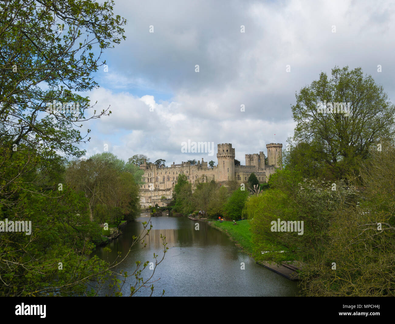 View along River Avon to the magnificent Warwick Castle Warwickshire England UK - Stock Image