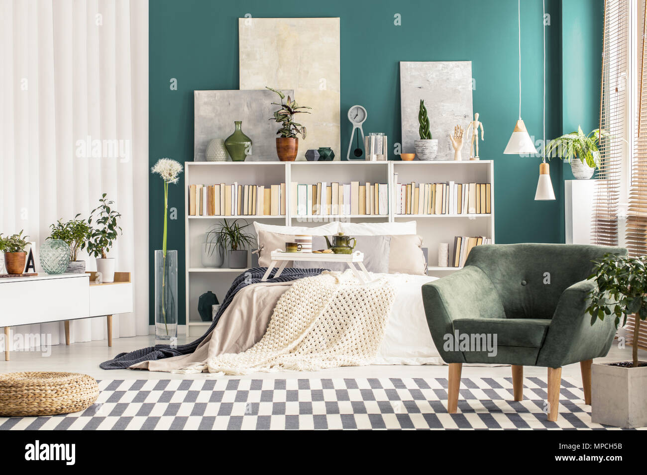 Cozy Bedroom Interior With White, Scandinavian Style Furniture And  Turquoise Green Wall