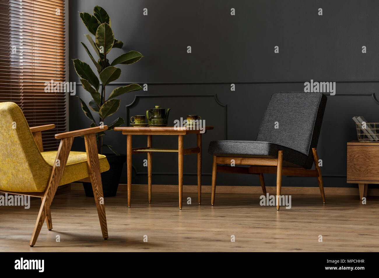Simple, dark retro living room interior concept with two chairs ...
