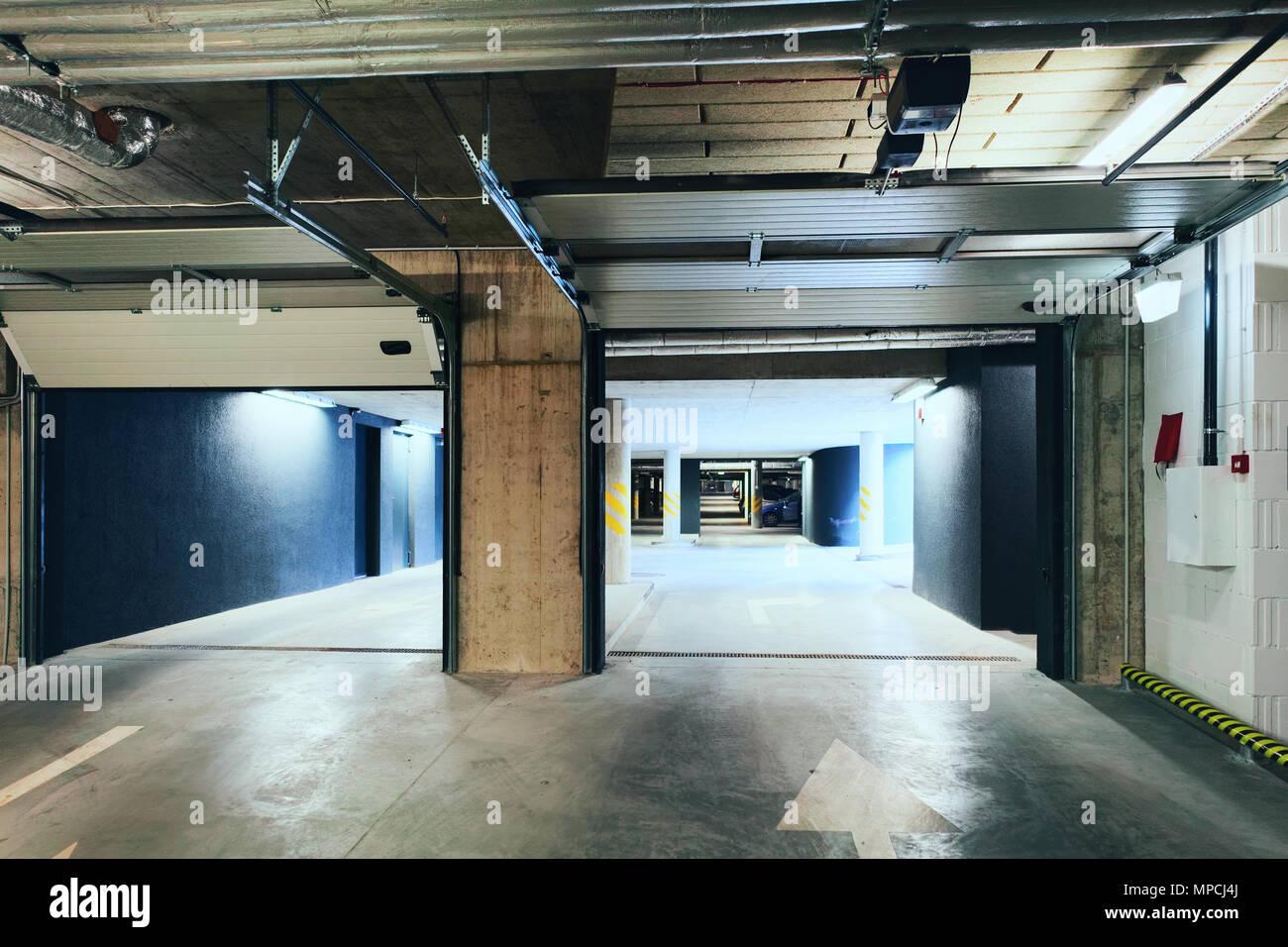 Underground Parking garage of a modern apartment building ...