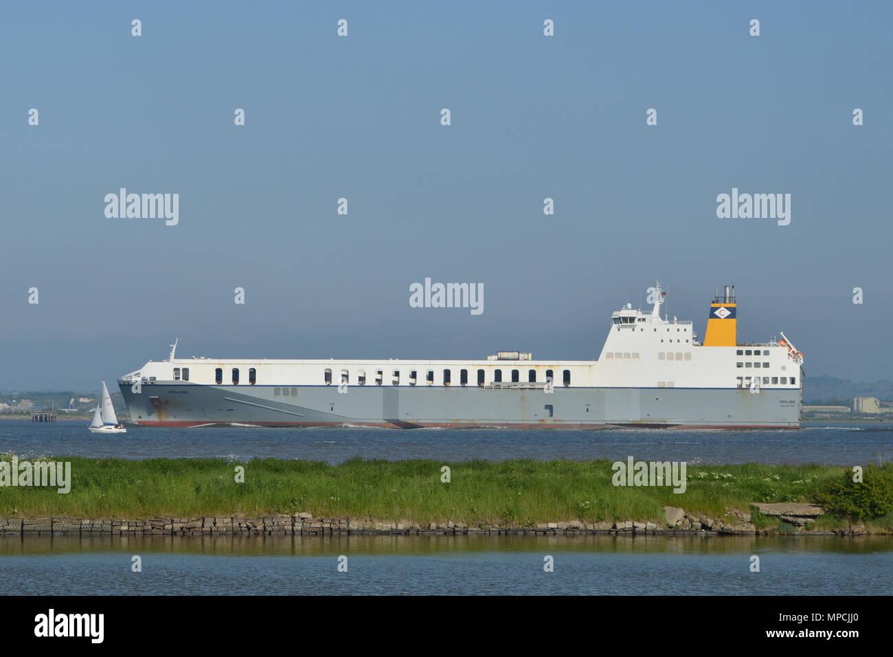 Ro-Ro Cargo Ship seen on the River THames near East Tilbury - Stock Image