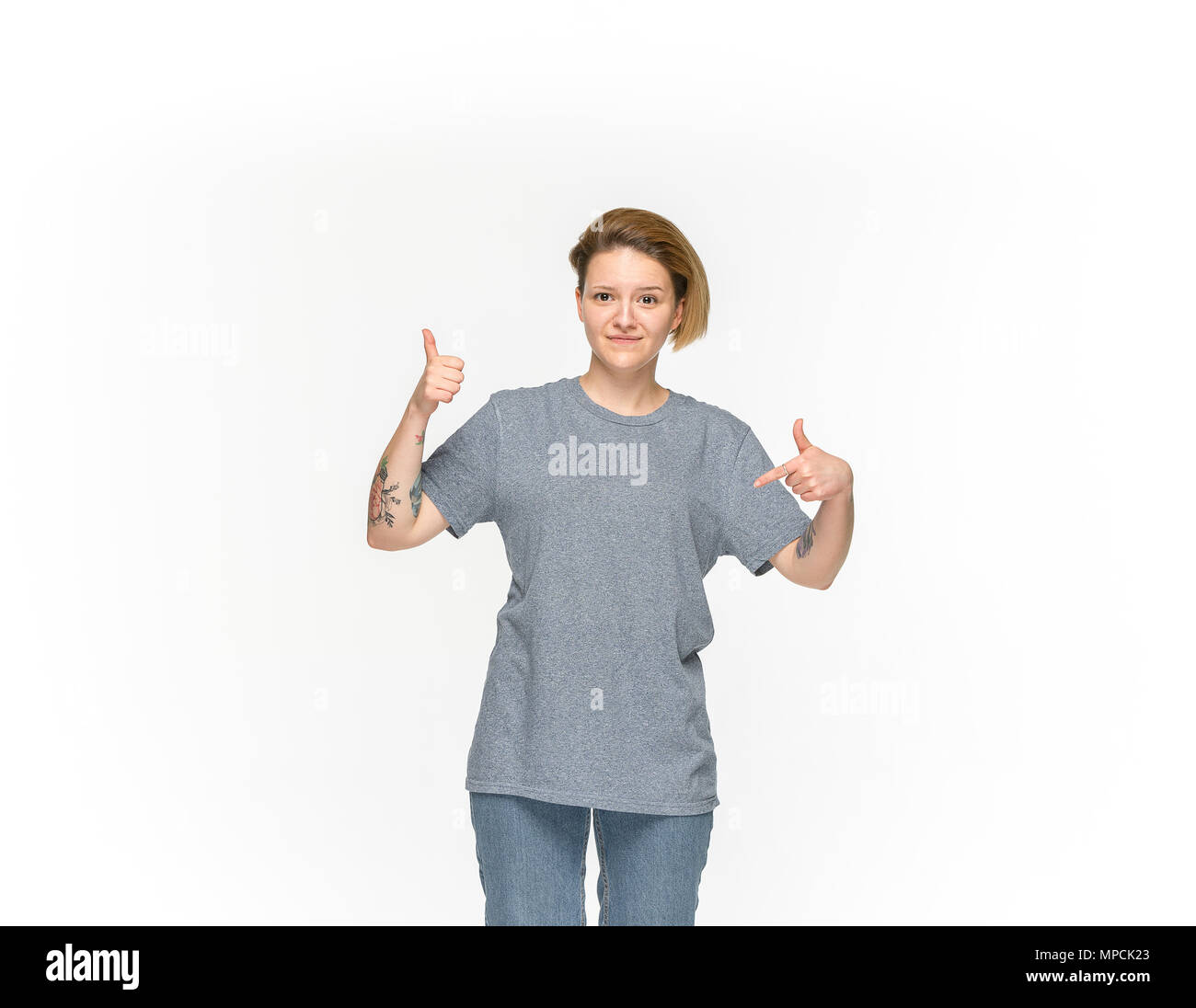 f8b6eb720db9 Closeup of young woman s body in empty gray t-shirt isolated on white  background.
