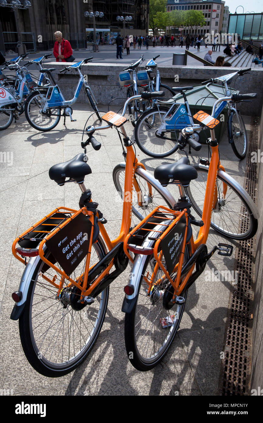 Germany, Cologne, rental bikes of the competing providers Donkey Republic and German Railway (Ford-Pass-Bike, DB Call a Bike) at the main station.  De Stock Photo