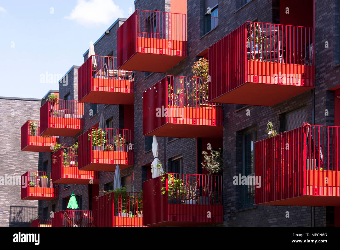 Germany, Cologne, red balconies of the apartment building Clouth 3 in the Clouth quarter in the district Nippes, Kister Scheithauer Gross Architects.  Stock Photo