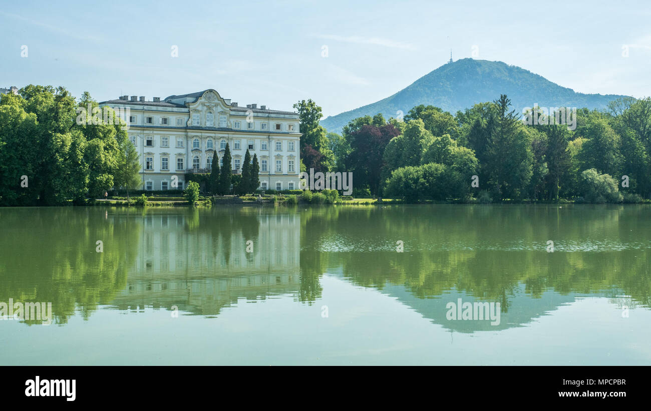 The rococo styles 'Leopoldskron Palace', in the district  Salzburg, Austria. Location for the lake shots in the musical film 'The Sound of Music' - Stock Image