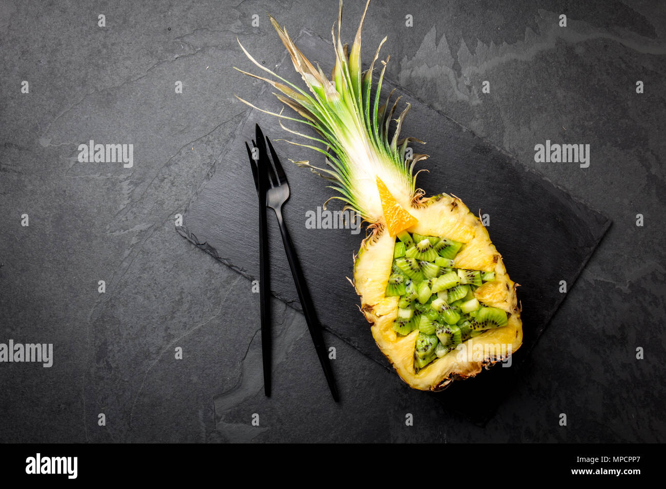 holiday diet concept or tropical christmas menu concept christmas tree made from pineapple and kiwi