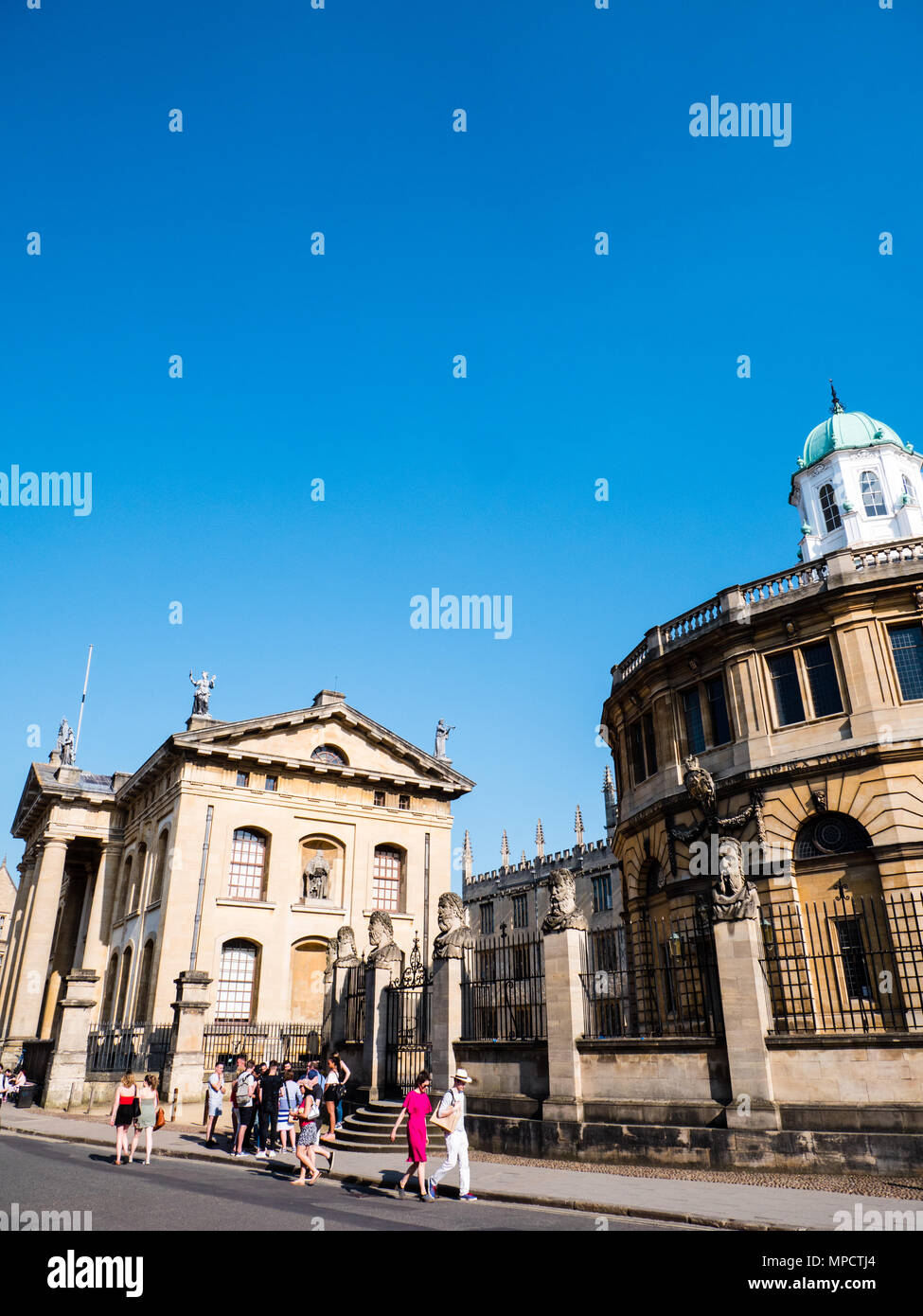 Tourists outside, Clarendon Building, and The Sheldonian Theatre, University of Oxford, Oxfordshire, UK, England, UK, GB. Stock Photo