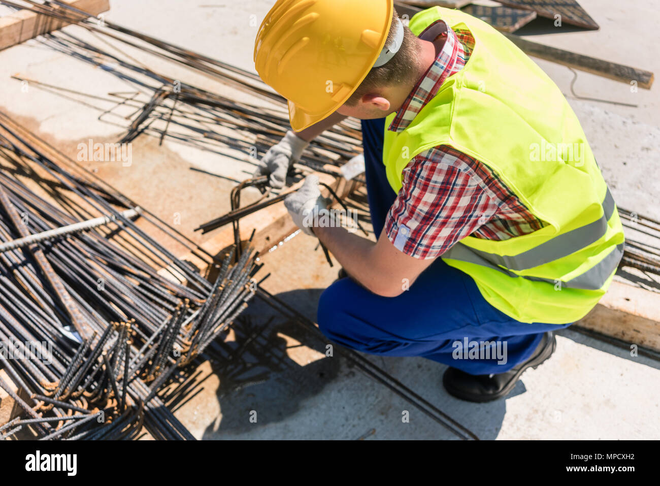 Reliable worker checking the quality of the steel bars - Stock Image
