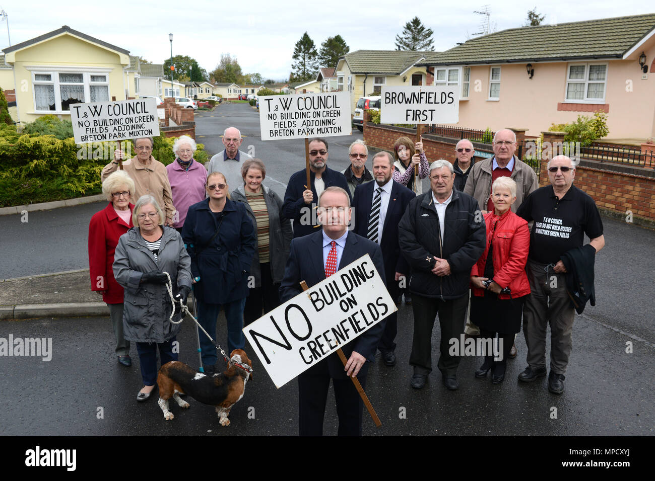 Mark Pritchard MP with residents protesting about plans to build on greenfield sites at Breton Park in Muxton, Telford. - Stock Image