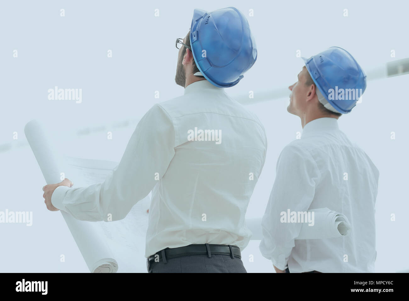 rear view.architect and Builder looking at blank screen - Stock Image