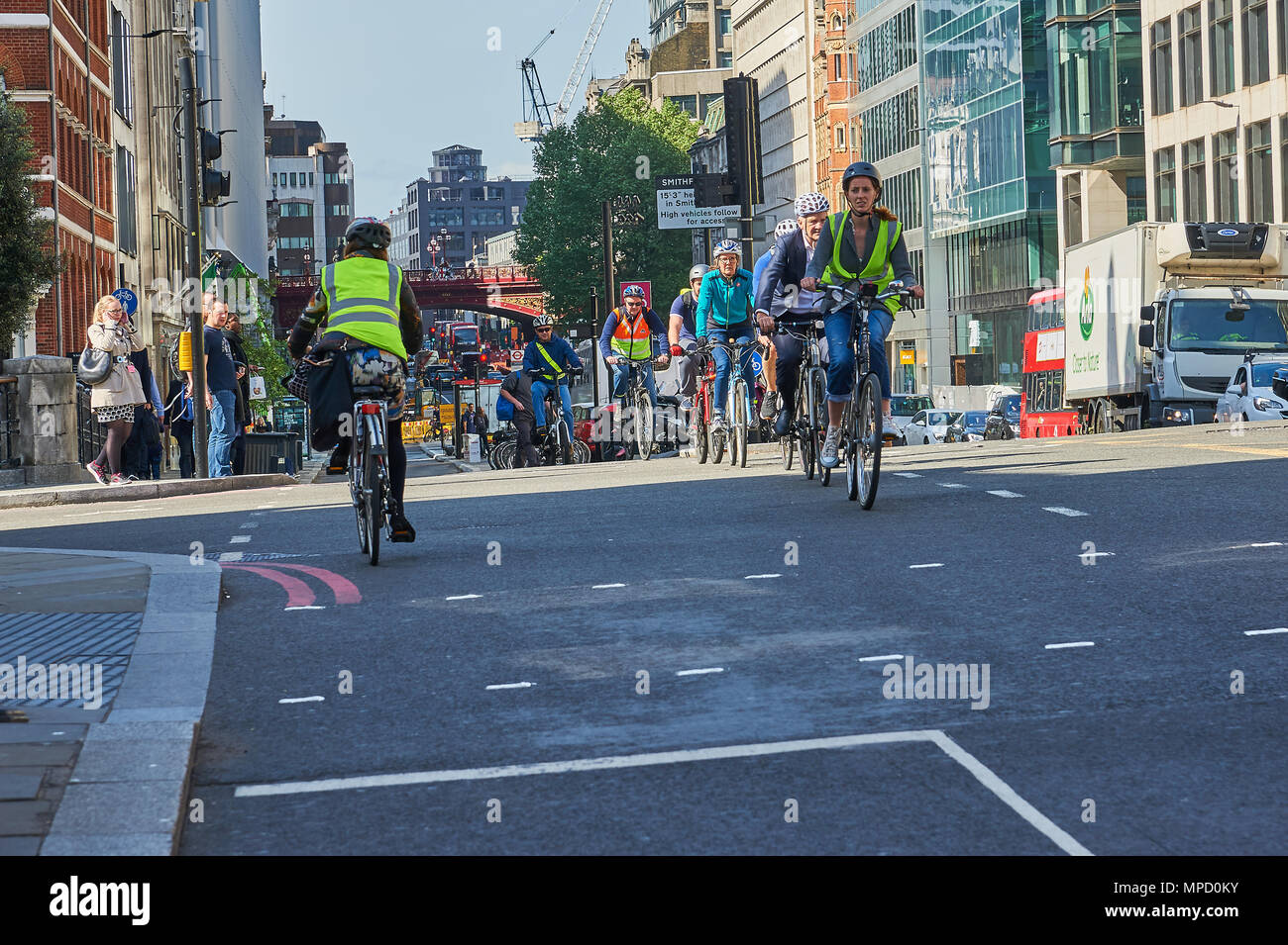 Cycling in London has increased since the introduction of better infrastructure and segregated bicycle lanes. - Stock Image