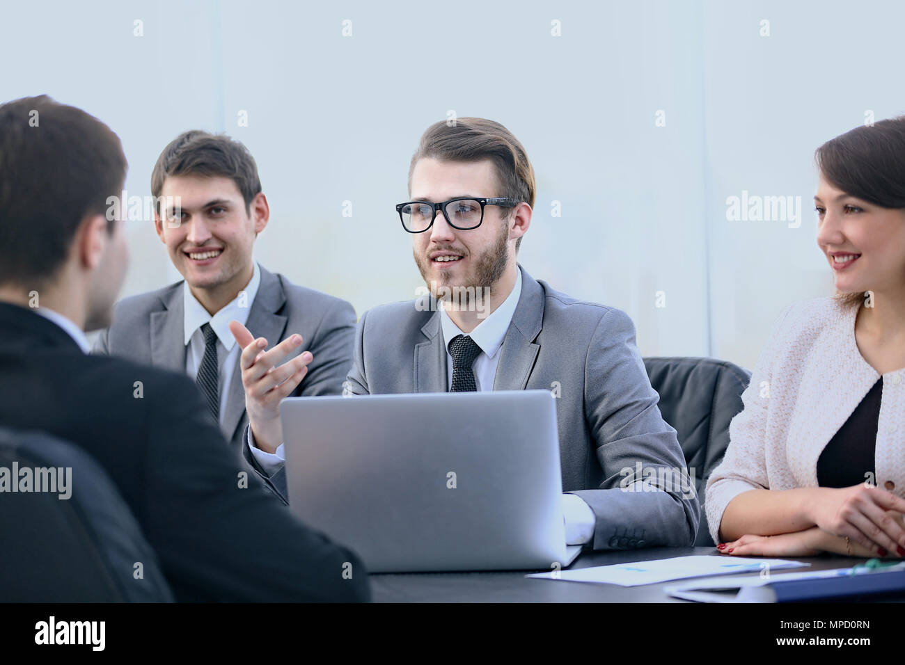Manager communicates with the client in the office - Stock Image